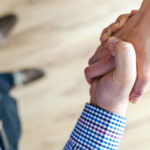 close up of a handshake between two men in business attire